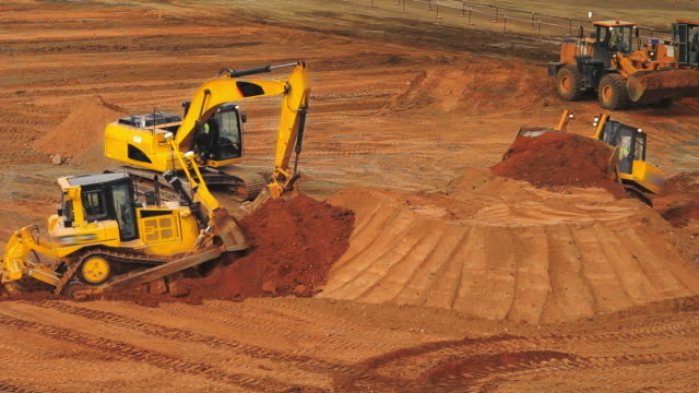 Construction equipment at mining quarry. Mining industry. Mining machinery Construction equipment at mining quarry. Construction machinery working on construction site. Mining industry. Mining machinery. Caterpillar equipment moving ground with scroop construction machinery stock videos & royalty-free footage