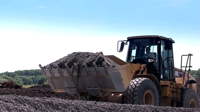 Construction equipment at work. Building. Bulldozer. Construction equipment does the job. Bulldozer. Construction equipment at work. construction equipment stock videos & royalty-free footage