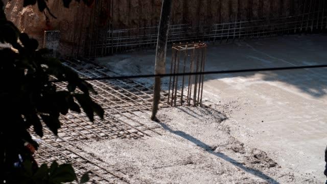 Construction Industry, Close-Up of a Concrete Pump Pouring Concrete, Working, Reinforcement of Concrete Casting Formwork