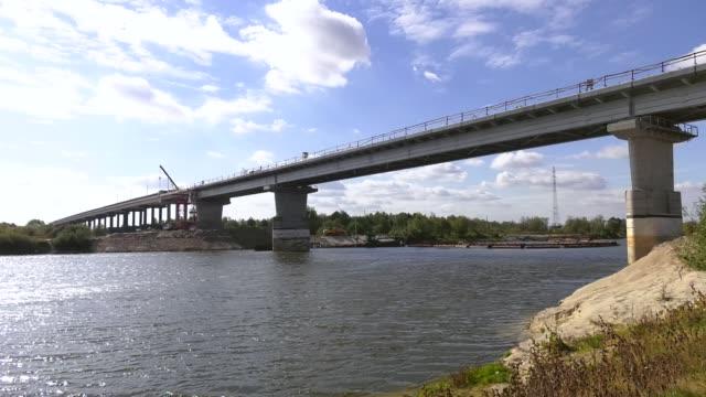 Construction of a concrete bridge. Construction of an automobile bridge at a construction site. process of bridge construction to pass through it motorways