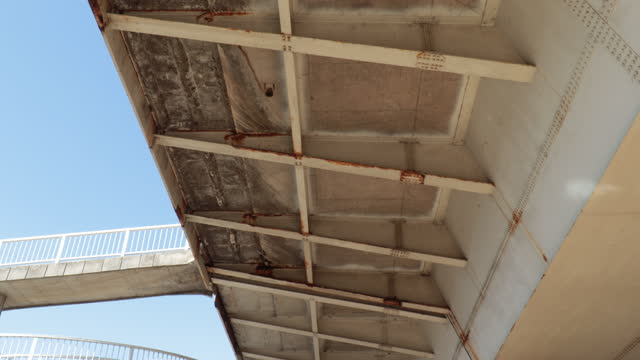 Construction of a metal bridge with rusty places at the joints caused by rain and moisture
