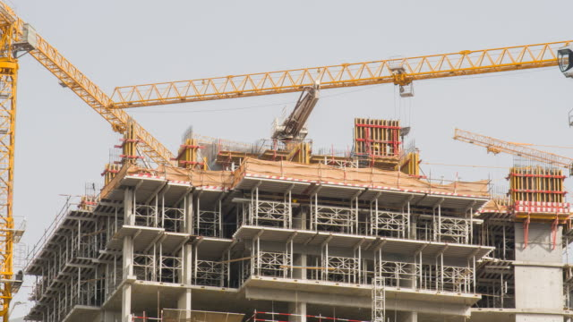 Construction of a multi-storey building in Dubai. Construction cranes in motion. Timelapse Construction of a multi-storey building in Dubai. Construction cranes in motion. Timelapse dubai architecture stock videos & royalty-free footage