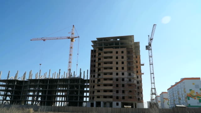 Construction of multi-storey buildings.Cranes work video