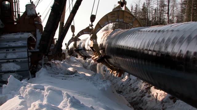 construction of oil pipeline - pipeline bildbanksvideor och videomaterial från bakom kulisserna