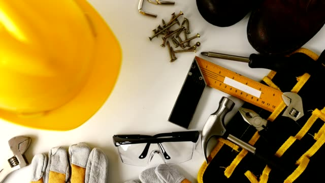 Construction safety equipment and tools on white background Construction safety equipment and tools on white background craftsman architecture stock videos & royalty-free footage