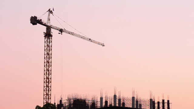 Construction silhouette at sunset Construction silhouette at sunset (HD) crane construction machinery stock videos & royalty-free footage