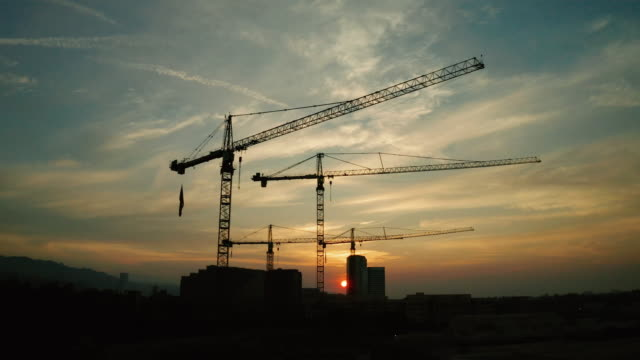 Construction Site - Aerial View of Cranes at Sunset