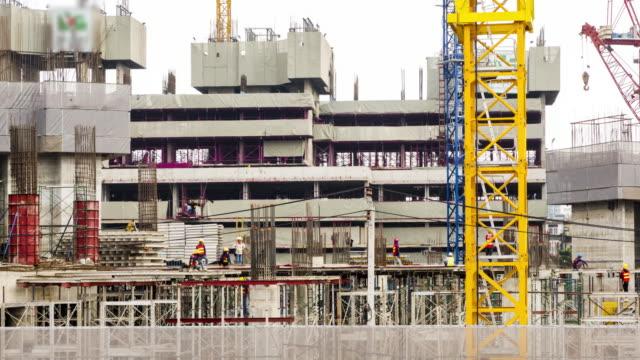 4k time lapse (4096x2160) :construction site at hong kong.zoomin styles. - betonowy filmów i materiałów b-roll