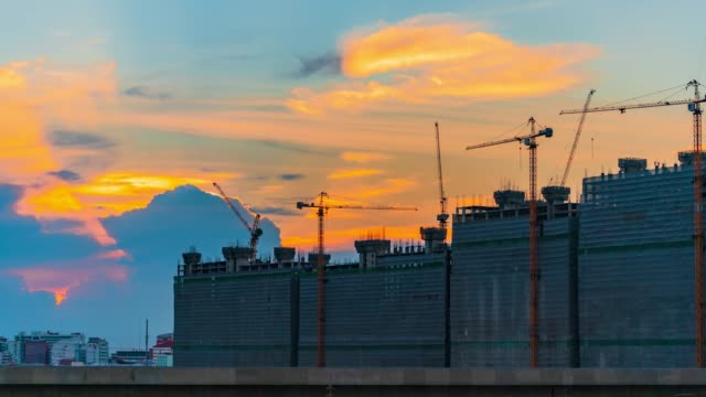 Construction site at sunset with Skytrain in Thailand