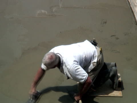 construction site: concrete smoother - one mature man only stock videos & royalty-free footage