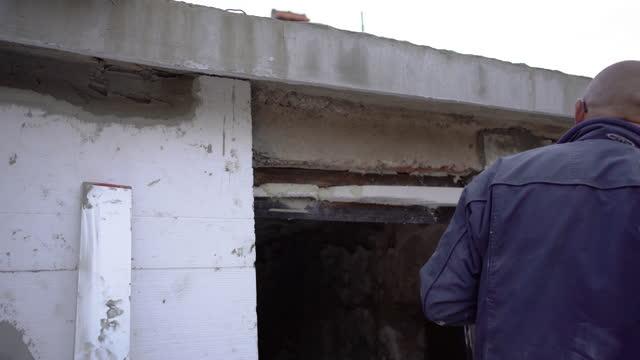 Construction site - Installing external insulation Facade therm