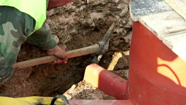 UHD Construction site manual digging hand work, Sony 4k shot video