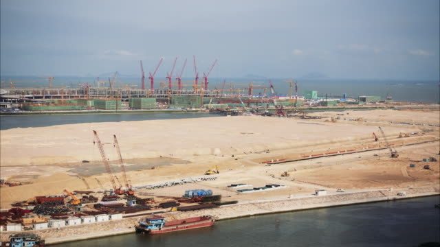 construction site on man made islands time lapse - zhuhai video stock e b–roll