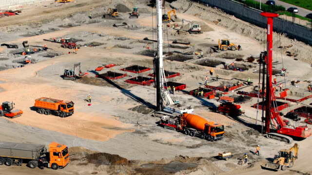 Construction site timelapse. Top view of an early stage of construction site, timelapse. Shot on a sunny day, HD construction vehicle stock videos & royalty-free footage