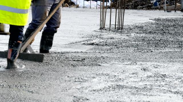 construction site, unrecognizable workers, cement video
