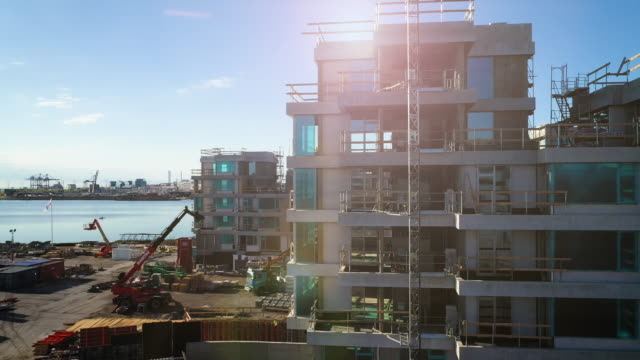 Construction site Aerial view of Construction site at Tuborg Havn and Svanemøllen in Copenhagen, Denmark. 4k video shot with drone foundation make up stock videos & royalty-free footage