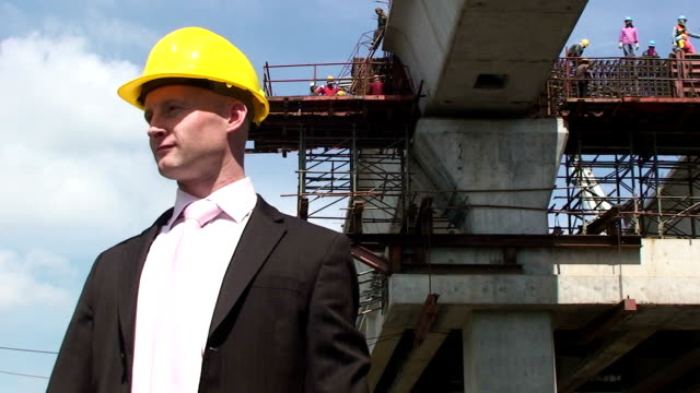Construction Site A constrution manager on a building site. craftsman architecture stock videos & royalty-free footage