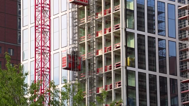 Construction site with elevator Construction site with elevator office park stock videos & royalty-free footage