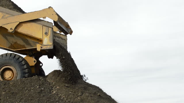 construction truck unloading river sand in a quarry - ghiaia video stock e b–roll