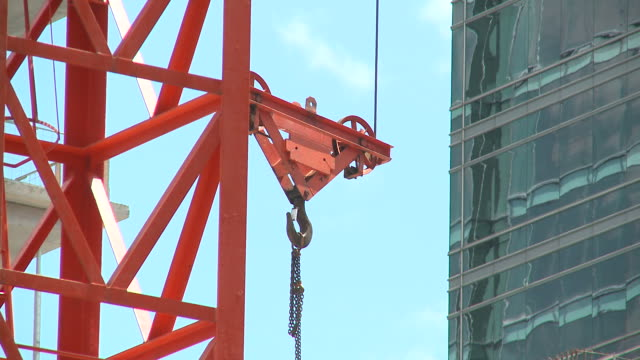 HD: Construction HD1080p: Close up view on the construction machinery. Camera following the object. crane construction machinery stock videos & royalty-free footage