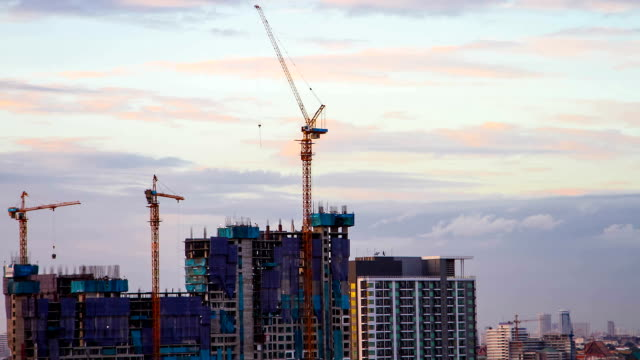 construction Building cranes and construction sites in the city. incomplete stock videos & royalty-free footage
