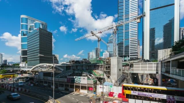 建設労働者と香港の建設現場のクレーン。 - 鎖の輪点の映像素材/bロール