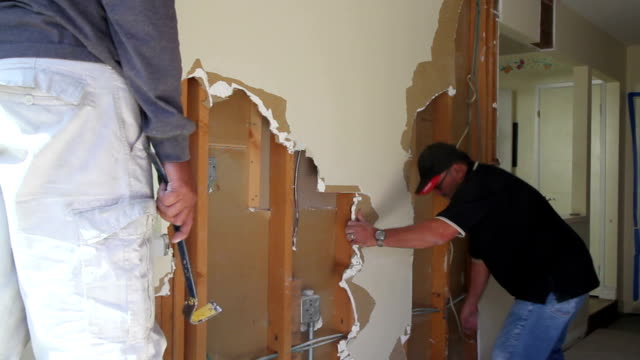 Construction Worker Demolishing a Wall video