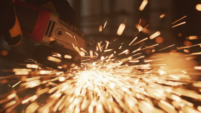 Construction worker grinding metal, closeup, slow motion Construction worker grinding metal, closeup, slow motion grinder industrial equipment stock videos & royalty-free footage