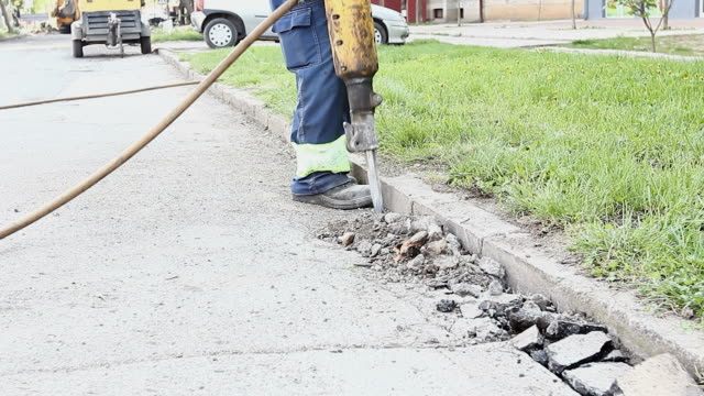 Construction worker is using jackhammer video