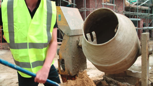 Construction Worker On Building Site Mixing Cement video