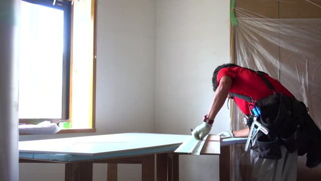 construction worker remodeling home - craftsman architecture stock videos & royalty-free footage