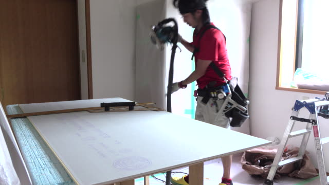 Construction worker remodeling home Construction worker remodeling home craftsman architecture stock videos & royalty-free footage