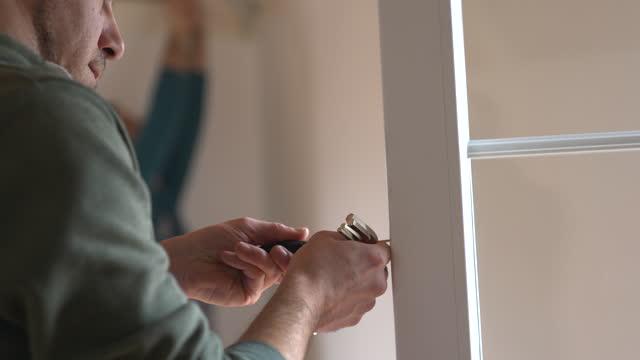 Construction worker repairing window video