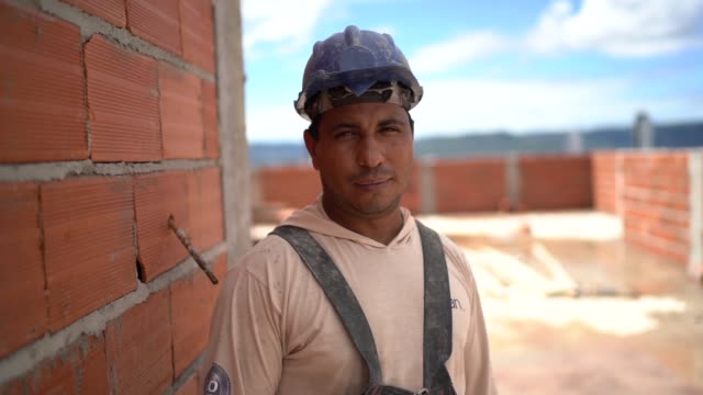 Construction worker standing in a construction site Construction worker standing in a construction site employment and labor stock videos & royalty-free footage