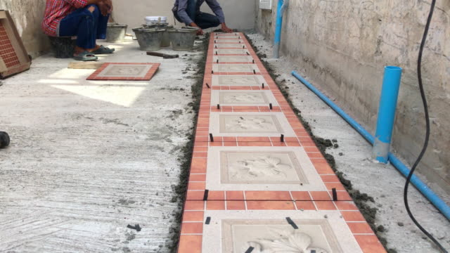 Construction worker tiling video
