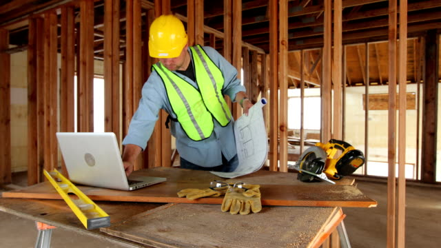 Construction worker using laptop computer video