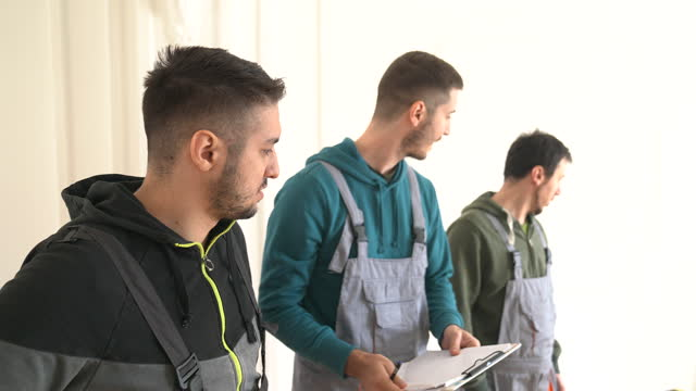 Construction workers planning a renovation video