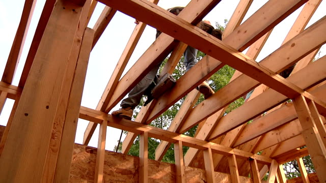 Construction Workers Builders working on new house. power tool stock videos & royalty-free footage
