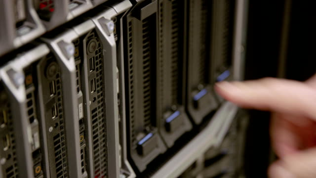 IT consultant power on a blade server in datacenter video