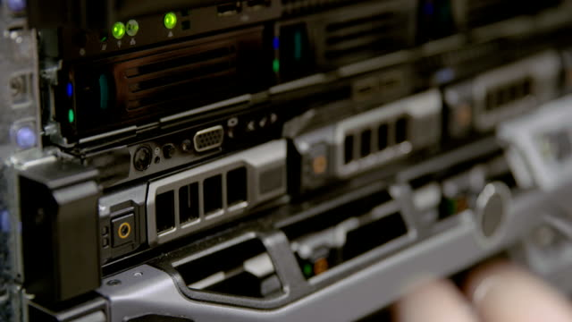IT consultant power on a rack server in datacenter video