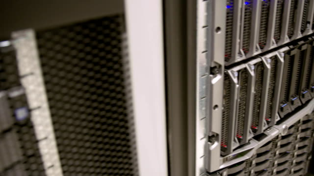 IT consultant remove blade server in datacenter video