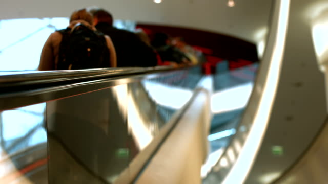 Consumers Riding Escalator In Shopping Mall (4K/UHD to HD) video