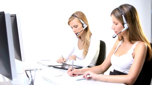 contact us female call center with headset working at desktop with computer video