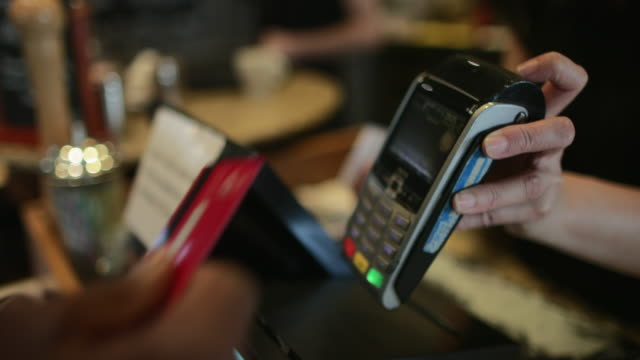 Contactless Card Payment An unrecognisable man at a cafe doing a contactless card payment. small business saturday stock videos & royalty-free footage