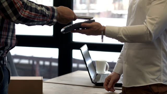 Contactless payment for a parcel with a smartphone. NFS technology. video
