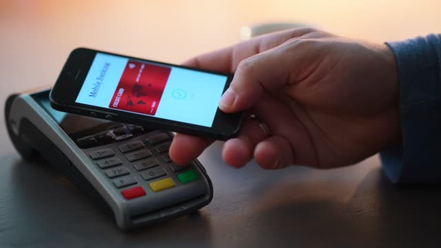 Contactless payment in the coffee shop Man in cafe paying contactless with smart phone contactless payment stock videos & royalty-free footage