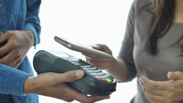 SLO MO Contactless Payment with Mobile Phone in a shop video