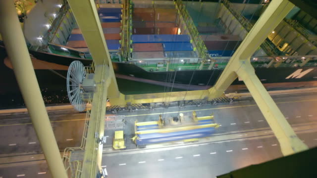 Container being loaded on cargo ship video