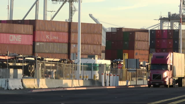 Container cargo and trucking Semi-trailer trucks at Port of Oakland oakland stock videos & royalty-free footage