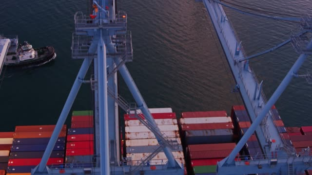 Container Cranes and Cargo Ship - Drone Shot video